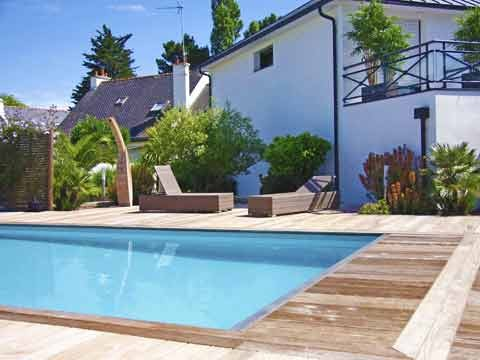 Un jardin design de paysagiste concarneau henri mignon for Amenagement plage piscine